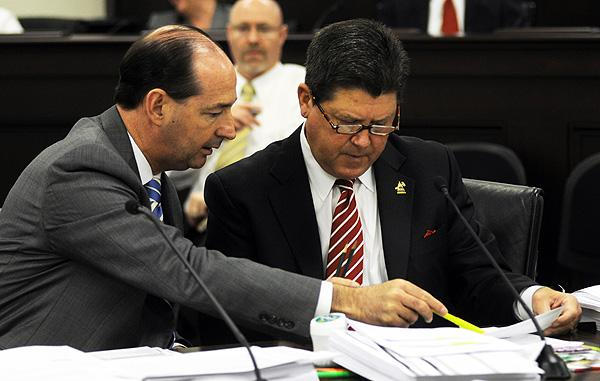 House Majority Floor Leader Rocky Adkins, D-Sandy Hook, pores over budget documents with House Speaker Greg Stumbo, D-Prestonsburg, during a meeting of the executive branch budget conference committee. - Photo by LRC Public Information