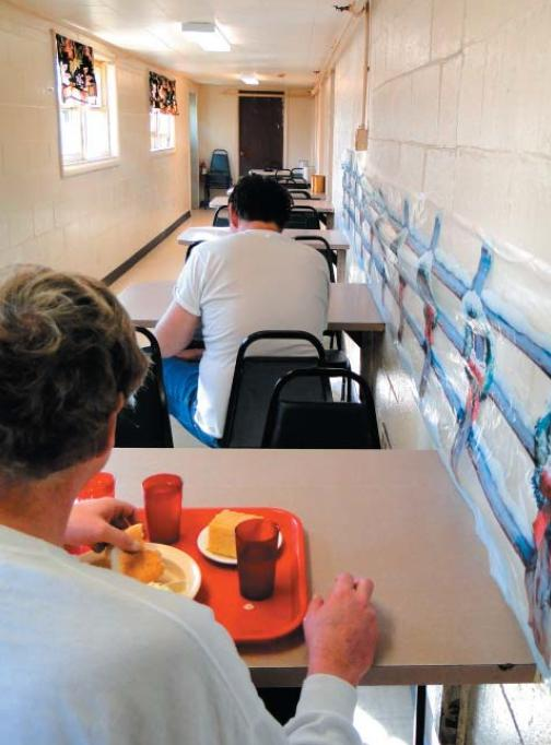 Residents of a personal care home eating at separate tables. - Photo by Kentucky Protection & Advocacy