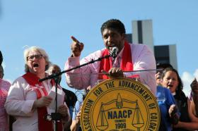 NC NAACP leader Reverend William Barber speaks to a crowd of Moral Mondays protesters at the capitol.