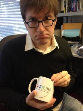Rico with WUNC Coffee mug
