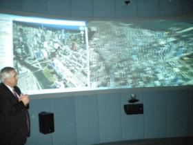 Dean Jim Ryan gives a demonstration of the 3-D visualization room
