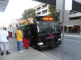Commuters in Winston-Salem board a P.A.R.T. express bus bound for Greensboro