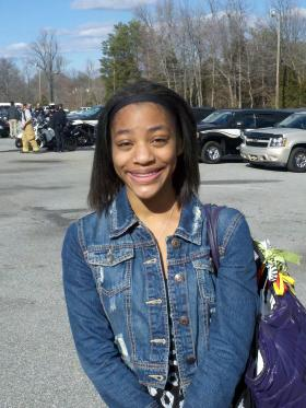 "Genesis Williams is a senior at Western Guilford HS. She watched a mock car crash on Wednesday in the school parking lot. The program, called ""A message 2 die 4"" is aimed at getting teenagers to think before texting while driving."