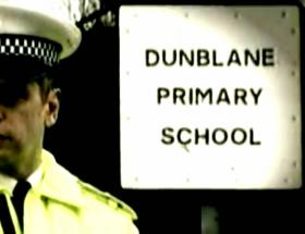 A photo of an officer outside Dunblane Primary School