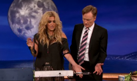 Pop singer Ke$ha teaches Conan O'Brien how to play a Theremin