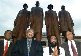 "Left to right: David ""Chip"" Richmond (son of the late David L. Richmond), Franklin McCain Sr. '63, Jibreel Khazan '63 & Joseph A. McNeil '63, standing in front of the statue commemorating the A&T Four."