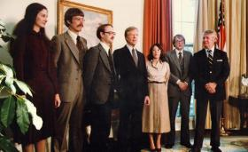 Photo of the six Americans who were rescued from Tehran and President Jimmy Carter