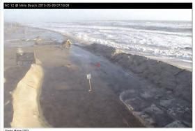 A screenshot captured Saturday at Mirlo Beach near Rodanthe shows the surf advancing on Highway 12.