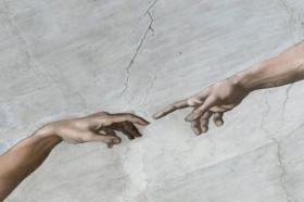 The Creation of Adam on the ceiling of the Sistine Chapel.