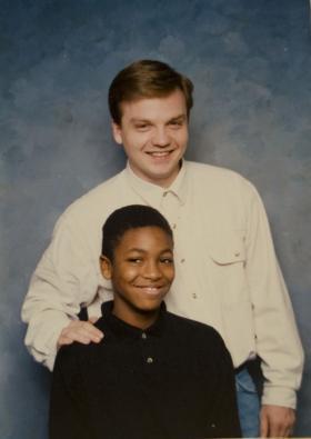Photo of Victor Checuga (seated) and Mike Checuga (standing)