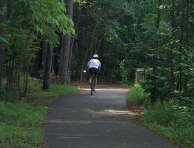 A cyclist on the Capital Area Greenway.