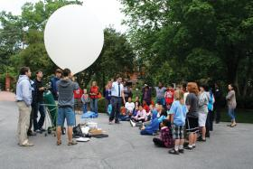 Students learning about a weather balloon at last year's North Carolina Science Festival.