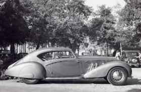 Photo: A 1937 Delage D8-120 Aérosport Coupe outside the October 1937 Paris Salon
