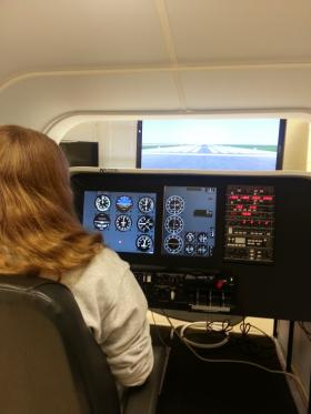 Hannah Wade takes control of the FAA-approved flight simulator at the Aviation Academy in High Point.
