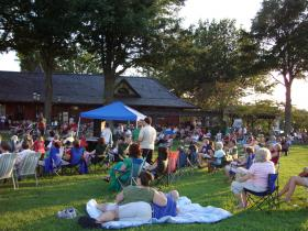 Crowds gather to listen to Jump Back Band at Burlington's Historic Train Depot as a part of their summer concert series.