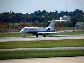 A plane lands at Piedmont Triad International Airport.