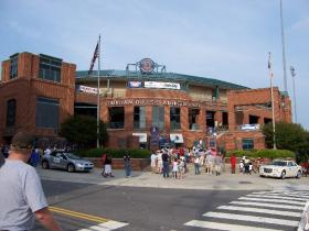 Durham Bulls Stadium with people in front.