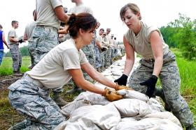 Air Force airmen lay sandbags to protect against a flooding disaster in MO in 2011.