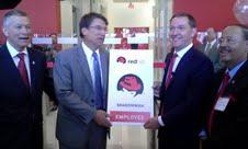 Gov. Pat McCrory (2nd from left) and Red Hat CEO Jim Whitehurst (2nd from right) open Red Hat's Raleigh headquarters.