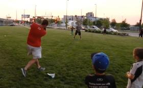 Wolfpack players Logan Ratledge (gray shirt) and Jake Armstrong (red shirt) playing baseball with Little Leaguers.
