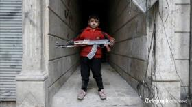 Photo: Child soldier with an AK-47