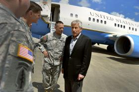 Secretary of Defense Chuck Hagel is greeted by Gen. Dan Allyn, commander U.S. Forces Command, as he visits Fort Bragg