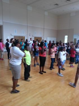 """Each morning the summer literacy program begins with a Harambee, a Swahiliword meaning """"let's pull together""""."""