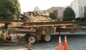 Remains of the CSS Neuse being moved by truck through Downtown Kinston.