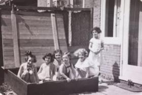 Photo: Amsterdam, 1937. Children sit in a sandbox, including Anne Frank  and Barbara Rodbell.