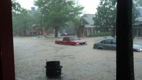 Several feet of flood waters trap cars on West Franklin St. in Chapel Hill Sunday afternoon.