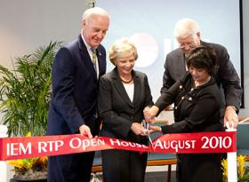 Madhu Beriwal (on right cutting the ribbon) when headquarters were moved from Baton Rouge, Louisiana, to the Research Triangle Park, North Carolina.