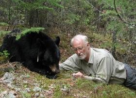 Photo: Lynn Rogers and a black bear