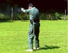 Rockingham County Sheriff Sam Page takes aim at a steel plate during a round of target practice earlier this month. Mayodan, a small town in the county, is the site of a new gun manufacturing plant that will create more than 450 jobs.