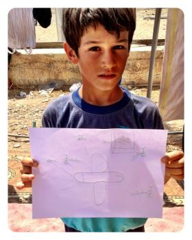 Photo: A child in a camp for Syrian refugees