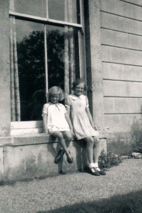 Photo: Sheila (left) and her sister Kathleen before their parents sent them to Boston