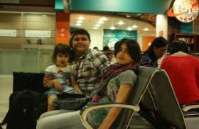 Photo: Mohammed, Mais and little Lamees wait in the airport in Amman to come to the U.S.