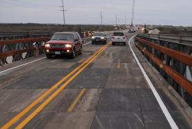The temporary metal bridge that currently spans where N.C. Highway 12 was destroyed by Hurricane Irene.  The state DOT is seeking a contractor to build a permanent bridge there.
