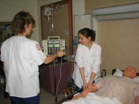 Nursing students working in the simulation lab during class.