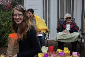 Emma smiles with bag of bulbs, Bernice in background