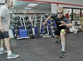 man with glasses, stroboscopic training, in running position