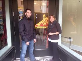 Matt Victoriano and Robin Young in front of Matt's new business, Intrepid Life Coffee & Spirits