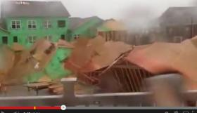Wind knocks down building