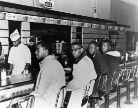 Joseph McNeil (from left), Franklin McCain, Billy Smith and Clarence Henderson sit in protest at the whites-only lunch counter at Woolworth during the second day of peaceful protest, Feb. 2, 1960.