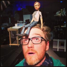 James Phillips of the band Bombadil poses with the puppet made in his likeness for the show