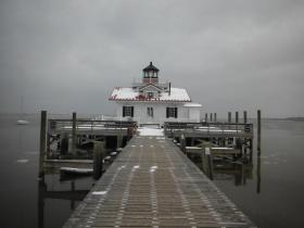 Caption from Twitter: Roanoke Marshes Lighthouse, beautiful even when surrounded by snow. 9:32 a.m. 1/29/14