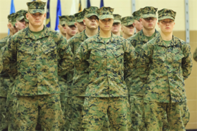 MARINE CORPS BASE CAMP LEJEUNE, N.C. - Pfc. Cristina Fuentes Montenegro, 25, one of the first three female Marine graduates from the School of Infantry-East's Infantry Training Battalion course, and native of Coral Springs, Fla., left, and Pfc. Julia Carr