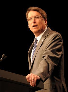 Gov. Pat McCrory stands at a podium and speaks to the Emerging Issues Forum on Monday.