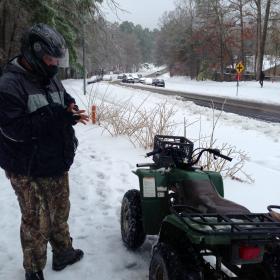 Jamie O'Briant of Durham takes a break from his four-wheeler near a pile-up.