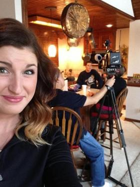 Tina Barnes (background) speaks to an interviewer. Annabeth Barnes shared the image with her followers.
