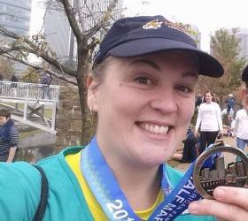 Beth Neel, at finish line of Richmond Half Marathon